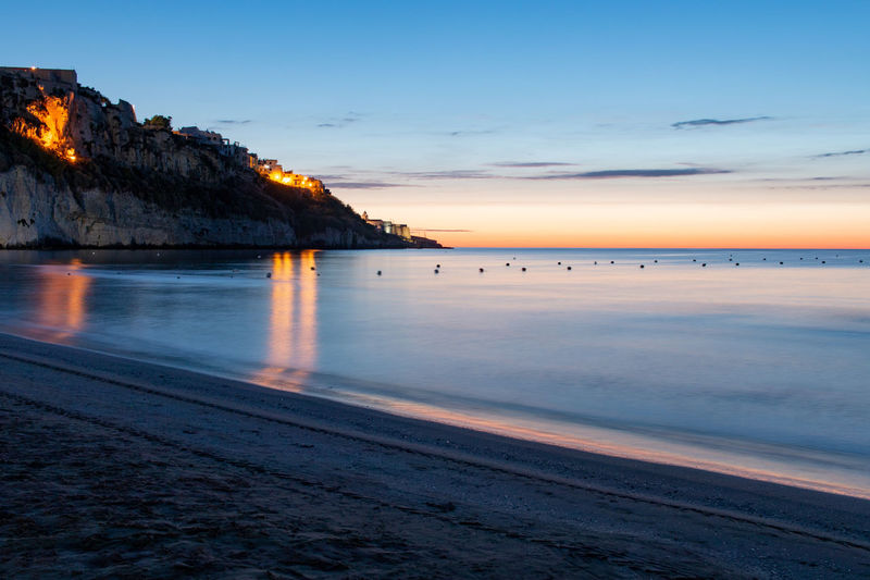 Blue hour Water Sky Sea Sunset Scenics - Nature Beauty In Nature Land Beach Tranquil Scene Nature Tranquility No People Idyllic Orange Color Dusk Cloud - Sky Outdoors Horizon Over Water Horizon Vieste Vieste Puglia