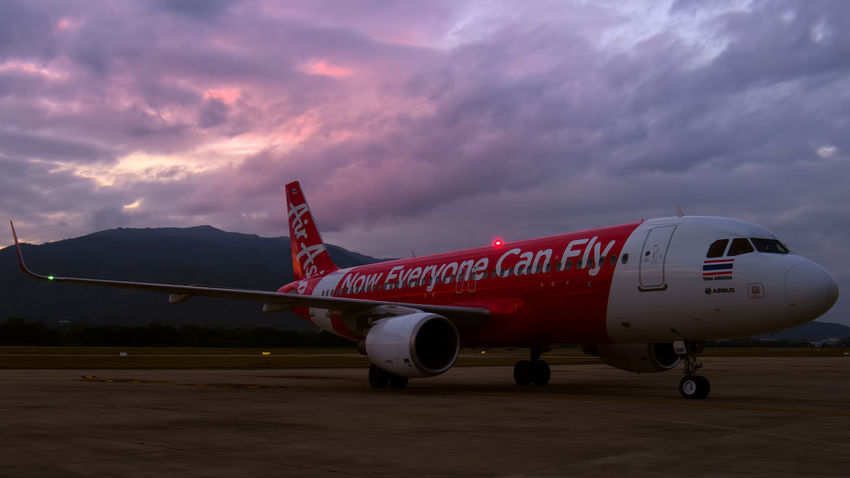 Thai Air Asia A320 taxiing to parking on a stormy evening in Chiang Mai! A320 Air Asia Airbus Airport Runway Cloud Cloud - Sky Cloudy Colorful Sky Day Doi Suthep Dusk Dusk Sky Illuminated Journey Mode Of Transport No People Outdoors Overcast Red Sharklets Sky Thai Air Asia Transportation Weather Winglets