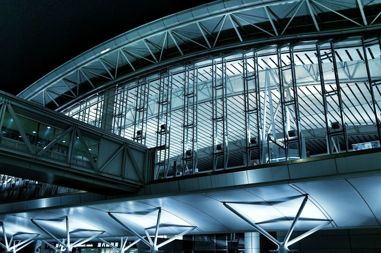 modern, architecture, built structure, glass - material, architectural feature, illuminated, indoors, metal, futuristic, low angle view, transportation building - type of building, airport, no people, day, city, sky