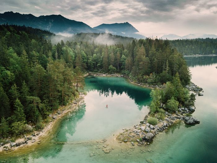 Kayaking in eibsee lake Water Mountain Beauty In Nature Scenics - Nature Tree Plant Lake Nature Cloud - Sky Mountain Range Non-urban Scene Sky Tranquility Tranquil Scene No People Reflection Coniferous Tree Forest Idyllic Land The Great Outdoors - 2018 EyeEm Awards