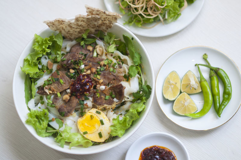 Vietnamese noodle - my quang, vietnamese traditional cuisine, noodles in bowl on the table