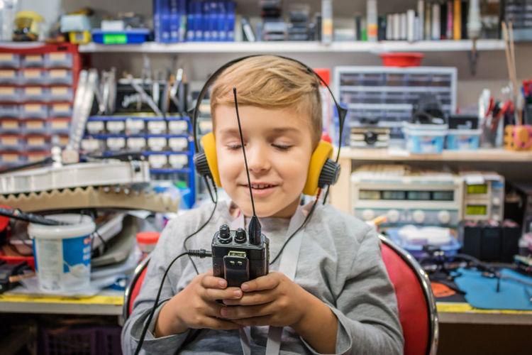 CB Radio Headphones WalkieTalkie Amateur Boys Caucasian Child Childhood Communication Connection Cute Holding Indoors  Laboratory One Person Portability Radio Amateur Radio Station Real People Smiling Technology Wireless Technology