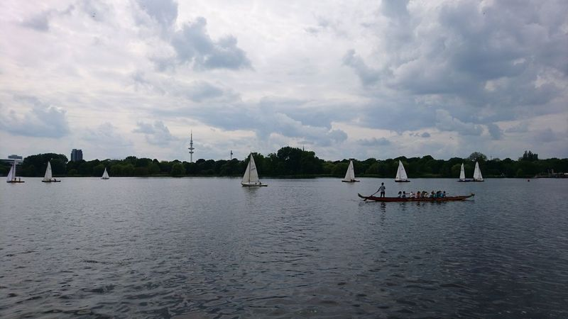 Alster with rowers. · Hamburg Germany Hh Alster Außenalster Alster River River Boats Rowing Rowers Clouds And Sky Clouds Water Reflections Symmetry