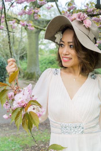 Pretty Filipino model in a park, UK. Beauty In Nature Blossom Blur Background Center Focus Cloudy Sky Countryside Day Daytime Filipino Foliage Full Dress Grass Lush Foliage Outdoors Outside Photography Park Plants Portrait Of A Woman Pretty Trees