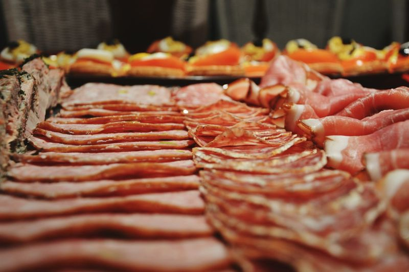 Close-up of salami arranged in charcuterie