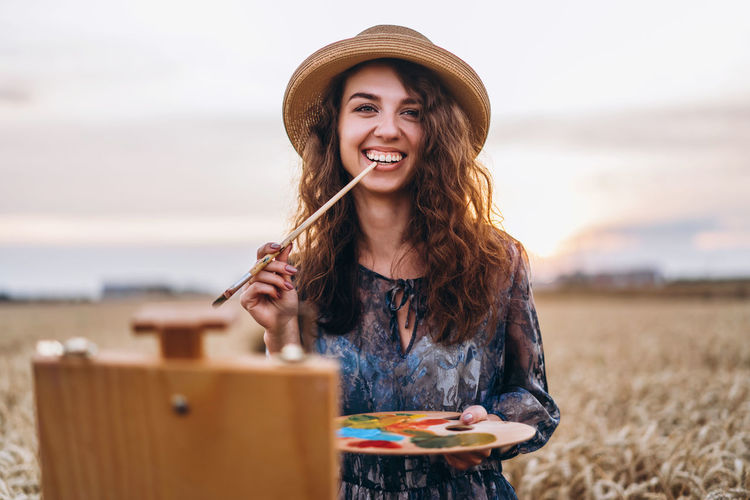 Portrait of a smiling young woman in hat