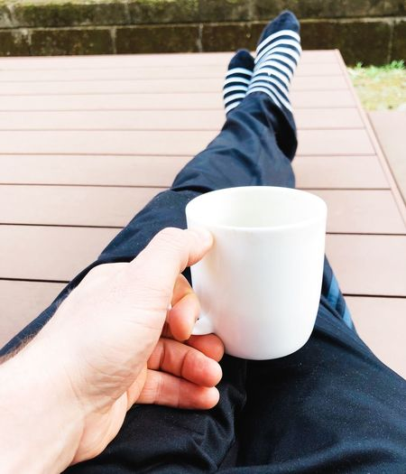 Low section of man with coffee