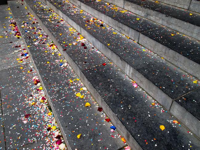 Colourful confetti on church steps Celebration Church Steps Colourful Confetti Fallen Grey Happy Happy Day No People Outdoors Petals Pretty Steps Stone Steps Street Thrown Confetti Wedding Wedding Day FreshonEyeem