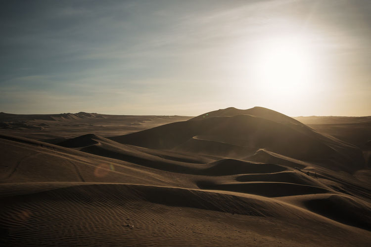 Finally we arrived at the dunes in Huacachina. Outdoors Nature Travel Destinations Mountain Range Mountain Moody Explore Discover  Adventure Non-urban Scene Arid Climate Landscape Environment Tranquility No People Desert Sand Dune Sunlight Lens Flare Bright Atmospheric Sun Remote Climate Sand