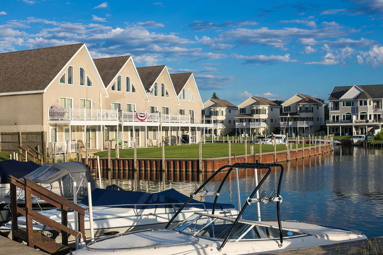 A view of condos in Port Austin, Michigan. Port Austin Port Austin, Michigan Relaxing Architecture Boat Building Exterior Built Structure Chair Condos Day No People Outdoors Riverview Sky Water