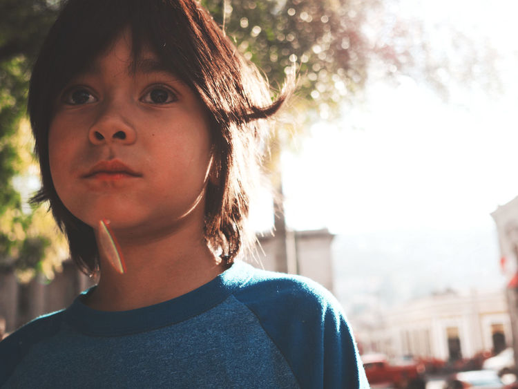 Boy Casual Clothing Childhood Close-up Day Focus On Foreground Front View Headshot Leisure Activity Lifestyles Looking At Camera One Person Outdoors People Portrait Real People Sky Sunlight Tree Xela , Quetzaltenango Young Adult