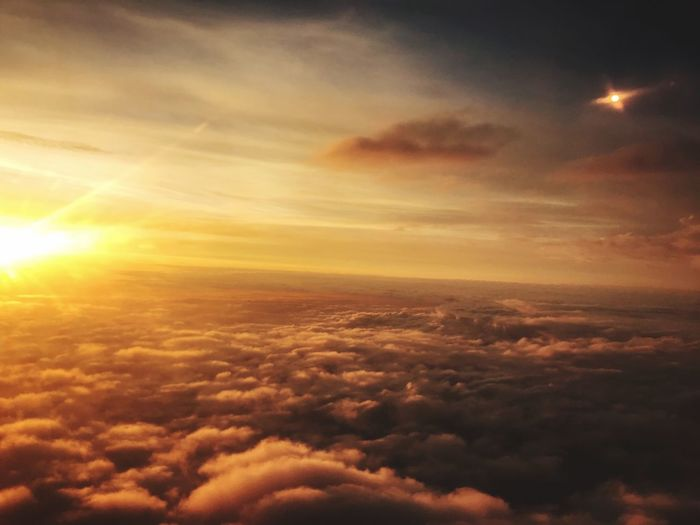 Cloud - Sky Sky Beauty In Nature Scenics - Nature Tranquility Tranquil Scene Nature Backgrounds Dramatic Sky Majestic Low Angle View Sunlight Lens Flare No People Outdoors Cloudscape Sunset Orange Color Idyllic Sun
