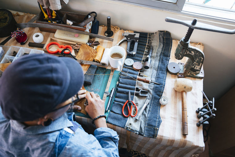 High angle view of tailor working on table at workshop