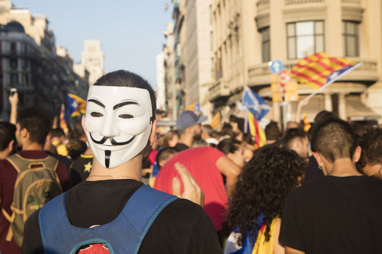 Barcelona, Spain - October 3, 2017. Demonstrators during protests for independence in Barcelona, Catalonia, Spain. Man wearing a Vendetta mask Barcelona Catalonia Catalonia Is Not Spain Democracy Freedom Independence Independencia Politics Protest Protest Signs Protests Rights Challenge Crowd Democratic Independent  March Political Politics And Government Protesters Protesting Protestor Protestors Riot Riots