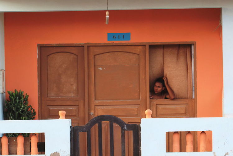 Architecture At The Window Building Exterior Built Structure Capo Verde Day Door One Person Orange And Brown Outdoors Sal Island Santa Maria Summer 2015 The Street Photographer - 2017 EyeEm Awards Wood - Material Young Woman