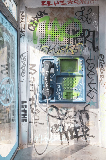 Athens Athens Greece Athens, Greece Acropolis Technology Telephone Connection Communication No People Day Telephone Receiver Pay Phone Outdoors Telephone Booth Graffiti Building Exterior Architecture Built Structure Text Transparent Cable Glass - Material Window Power Supply Electrical Equipment