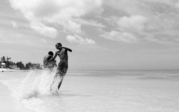 Bahamas Beach Beauty In Nature Black And White Blackandwhite Caribbean Caribbean Life Funtime Island Life Jumping Kids Lifestyles Nassau Nassau, Bahamas Old Bahamas People Sea Splashing The Bahamas Two People Water