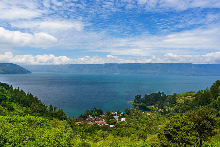 Lake Toba of Sumatra - Indonesia ASIA Danau INDONESIA Sumatra  Toba Tranquility Blue Cloud - Sky Horizon Over Water Lake Landscape Scene Scenery Scenics Sky Tourism Travel Destinations Village Vulcanic Water