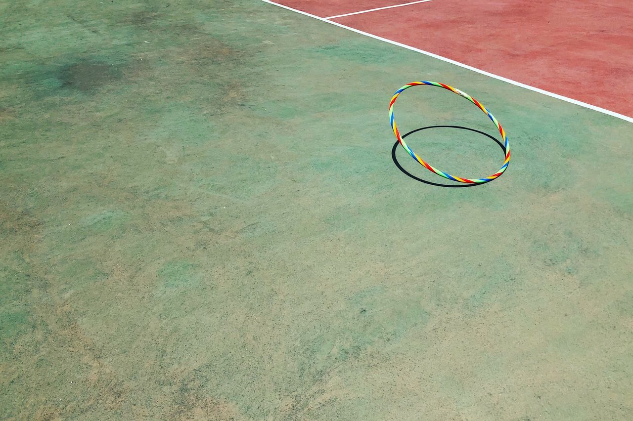 High angle view of hoop at basketball court during sunny day