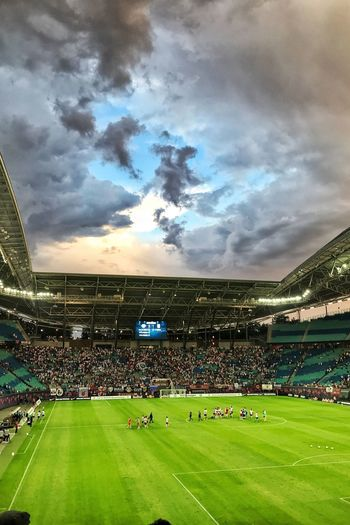 Soccertime Clouds And Sky Sommer 2018 Sport Grass Stadium Sky Team Sport Cloud - Sky Group Of People Soccer Plant Crowd Nature Green Color Playing Field Soccer Field Large Group Of People Real People Day Outdoors Competition Spectator