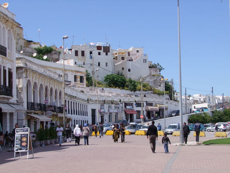 Buildings around the Docks Architecture Blue Sky City Clear Sky Composition Dockside Full Frame Incidental People Moroccan Architecture Moroccan Style Morocco Outdoor Photography People Residential Buildings Shops Sunlight And Shadow Tangier Tangier Old City Whitewashed Walls
