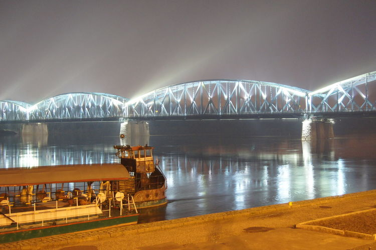 Bridge - Man Made Structure Travel Destinations Torun, Poland Arts Culture And Entertainment Reflection Business Finance And Industry Night Architecture Beach Water Sea Vacations Landscape Cityscape Outdoors No People City Sky Torun EyeEmNewHere Toruń Poland