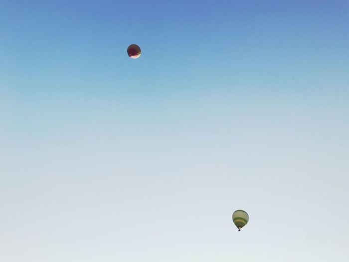 Low angle view of hot air balloons flying in sky