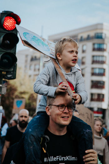Portrait of father and son in city