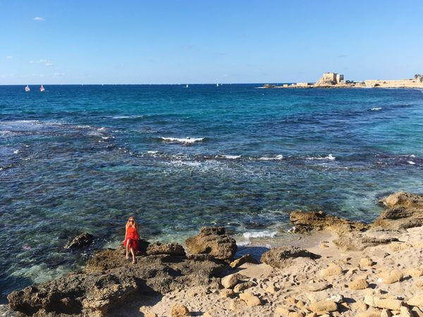 Sea Real People Water Rock - Object Clear Sky One Person Beach Nature Beauty In Nature Day Horizon Over Water Scenics Leisure Activity Outdoors Standing Lifestyles Vacations Full Length Blue Sky Caesarea
