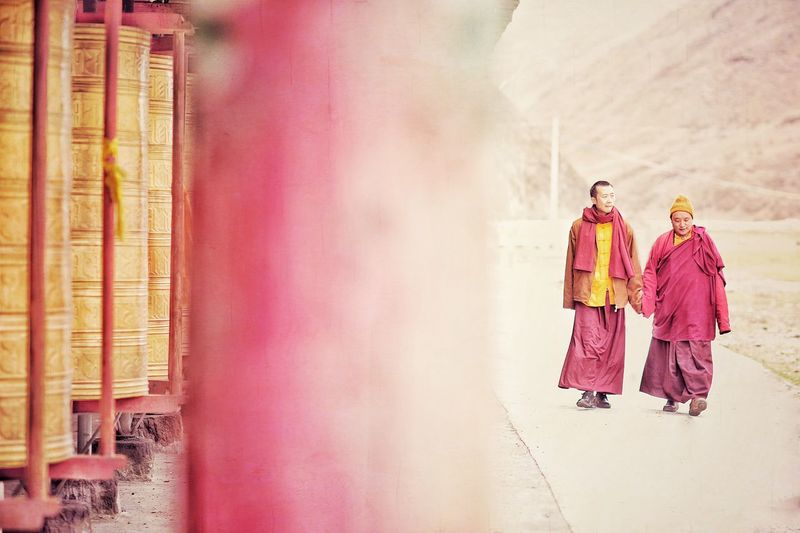 Monks walking at buddhist temple