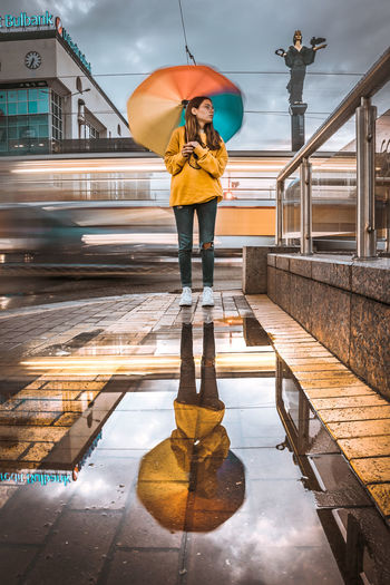 EyeEmNewHere Women Nature Rain Outdoors Umbrella Young Women Wet Lifestyles Casual Clothing Young Adult Architecture Rainy Season Colors Colourful Lights Urban Street