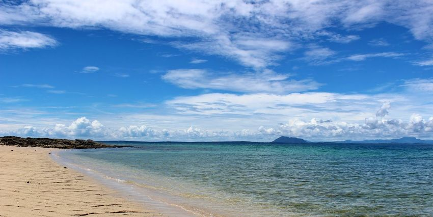 Beautiful serene beach scenes with bright blue skies, fluffy white clouds, and rocky sandy shores taken in Nosy Tanikely, Madagascar. Indian Ocean Nosy Be Peaceful Beach Scene Rocky Shore Beach Beach Landscape Beaches Of The World Beautiful Beach Beauty In Nature Blue Sky And Clouds Cloud - Sky Day Horizon Over Water Landscape Landscape_photography Madagascar  Madagascar Beach Nature No People Outdoors Scenics Sky Tranquil Scene Tranquility Water
