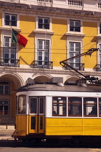Tram Against Buildings In Lisbon, Portugal