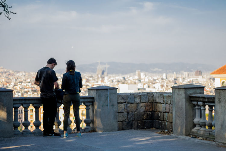 Friendship Togetherness Winter Leisure Activity Couple - Relationship Railing Rear View Bonding Outdoors Sky People Full Length City Day Women Adult Vacations Cold Temperature Men Couple Love Panoramic View Barcelona SPAIN Portrait Of A City