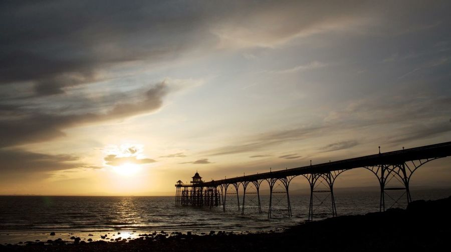 Silhouette Clevedon Pier Over Sea Against Sky At Sunset
