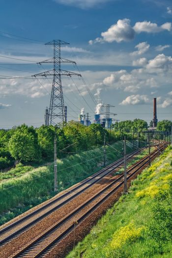 Rail Transportation Railroad Track Track Sky Plant Transportation Cloud - Sky Nature Technology Electricity  Day Electricity Pylon Fuel And Power Generation No People Cable Built Structure Tree Connection Public Transportation Architecture Power Supply Outdoors