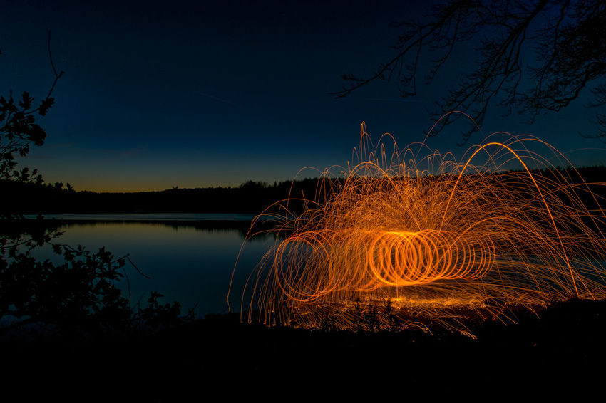 Be. Ready. Clear Sky Illuminated Lake Long Exposure Motion Night No People Outdoors Steel Wool Sunset Tranquil Scene Water Wire Wool