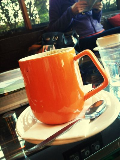 Orange cup of Coffee