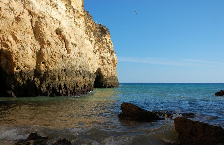 Rock formation in Faro, Portugal seaside. Beauty In Nature Day Faro Fårø Horizon Landscape Landscape_Collection Nature Nopeople Outdoor Photography Outdoors Outdoors Photograpghy  Rock Rock - Object Rock Formation Rock Formation Scenics Secrete Sky Sunset Tranquil Scene Tranquility Travel Traveling Water