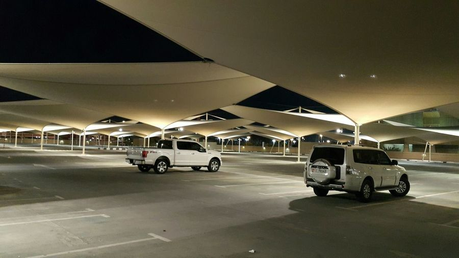 Parkinggarage Parking Deck Parking Area Area Parking Tent white car port No People Outdoors Transportation Cars