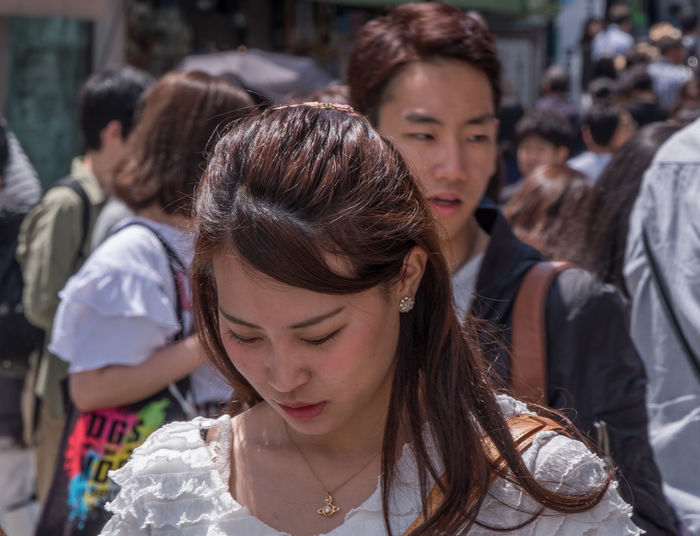 Woman looking at camera in city