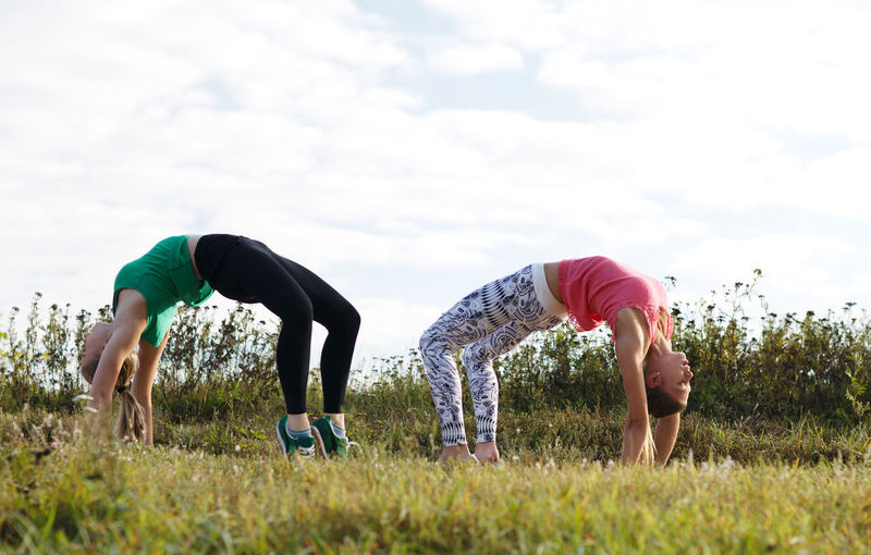 Athletic Countryside Exercise Field Fitness Girl Grass Gymnastics Outdoor Outdoors Person Physical Sport Sporting Together Train Training Two Woman
