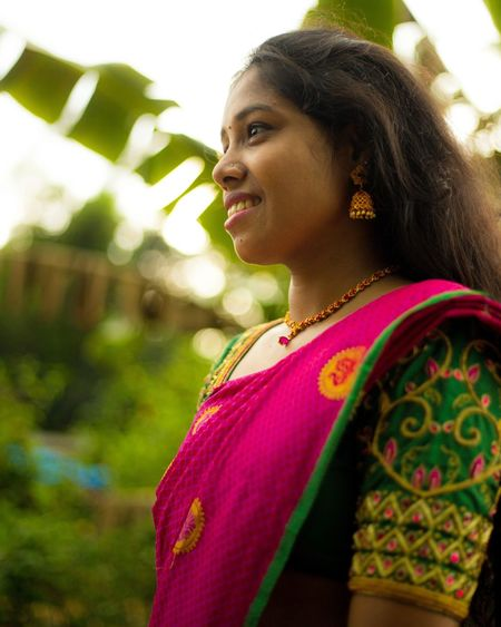 Side view of young woman wearing sari looking away