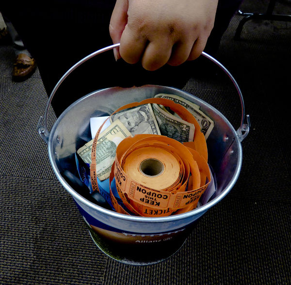 Metal bucket full of raffle tickets and American dollars Adults Only Bucket Chance Dollars Gamble Gambling Human Body Part Human Hand Lottery Money Money Money Orange People Prize Prizes Raffle Raffles Real People Ticket Tickets
