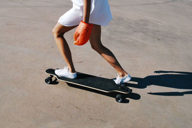Skateboard Sunlight Body Part Human Body Part Lifestyles Sport Human Leg Shadow Sports Equipment Motion Outdoors Healthy Lifestyle Real People Leisure Activity Transportation Crab Sneakers Longboard Longboarding Longboard Skating Summer In Motion Girls Women Activity