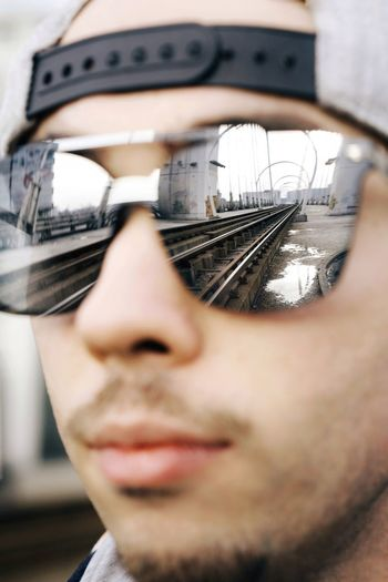 Train Tracks Reflection Sunglasses Architecture Man One Man Only People Human Face Portrait Headshot Close-up Vision Puddle Arch Bridge Bridge
