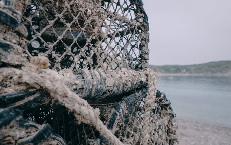 Close-up of fishing net on beach