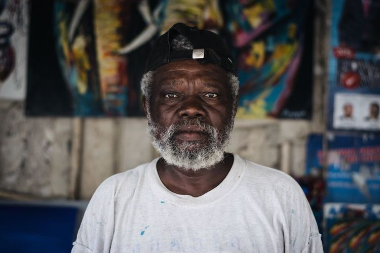 Wisdom Black Portrait Wise Man  tingatinga Painter Artist One Person Portrait Front View Headshot Real People Looking At Camera Beard Lifestyles Adult