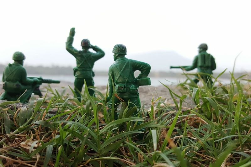 Close-up of toy soldiers on grass