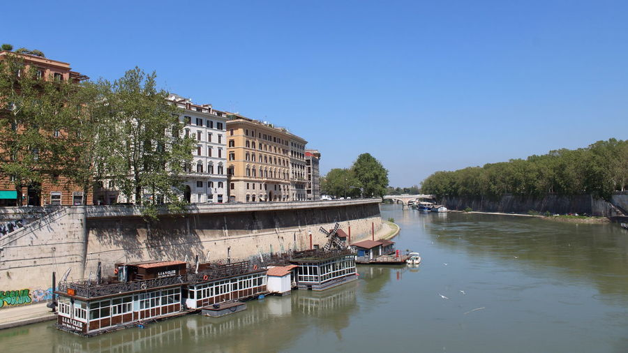 Rome Architecture Building Building Exterior Built Structure Clear Sky Day House Boat Nature Nautical Vessel No People Outdoors Plant Reflection River River City River Curve Sky The Tiber Transportation Tree Water Waterfront